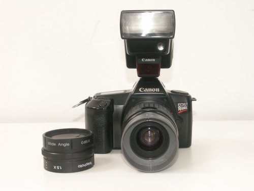 Canon Eos Rebel + 35-80mm + Flash 300EZ + aggiunti